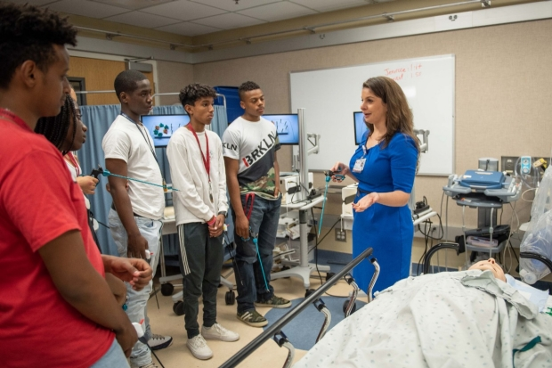 GSEC Education Fellow, Ingrid Schmiederer, teaching students laparoscopic skills.
